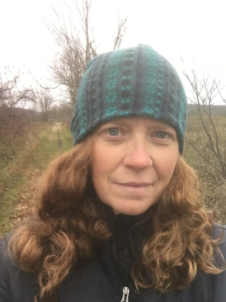 Maureen Brown outdoors in a knit cap